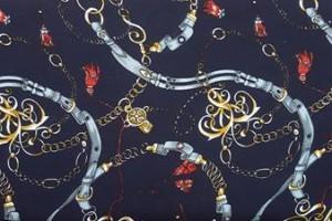 Sklep włókienniczy tkanina różne wzory żółta granatowa czarna