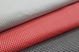 Sklep włókienniczy materiał szary czarny czerwony w groszki