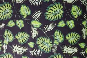 Sklep włókienniczy materiał czarny w zielone liście