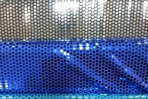 Sklep włókienniczy materiał świecący niebieski turkusowy kratka