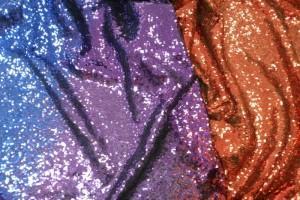 Sklep włókienniczy materiał świecący pomarańcz fiolet
