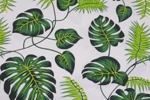 Sklep włókienniczy materiał biały w zielone liście