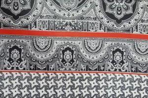 Sklep włókienniczy tkanina wzór z czerwonymi prążkami