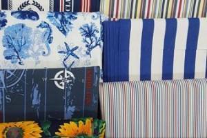 Sklep włókienniczy tkanina różne kolory wzory kwiaty paski liście