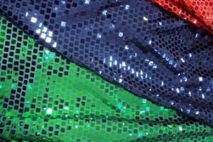 Sklep włókienniczy materiał czerwono-granatowo-zielono-złoty w cekiny