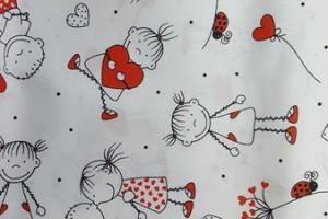 Sklep włókienniczy materiał biały chłopczyk i dziewczynka
